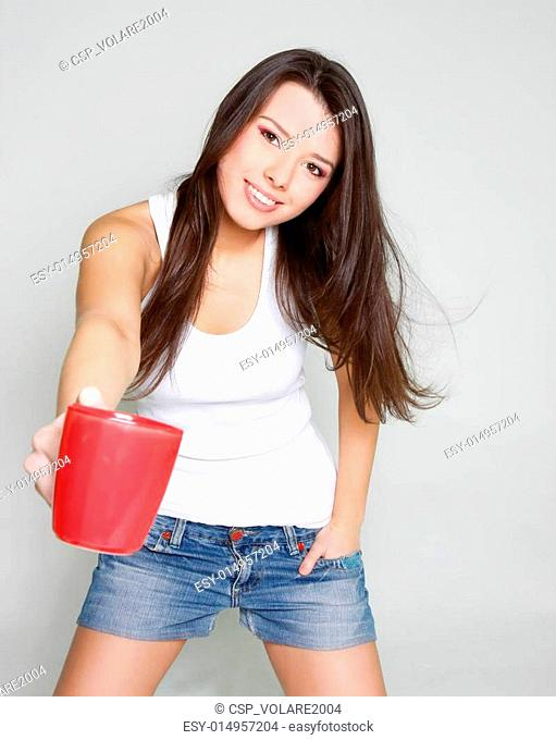 smiling young girl with red tea cup