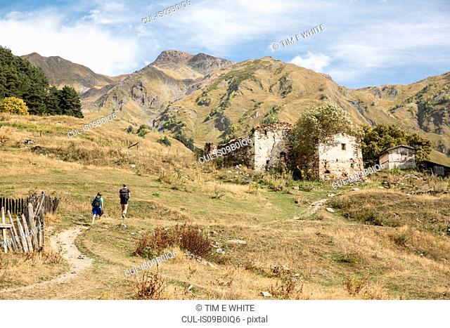 Male hikers hiking in mountain landscape, Svaneti, Georgia