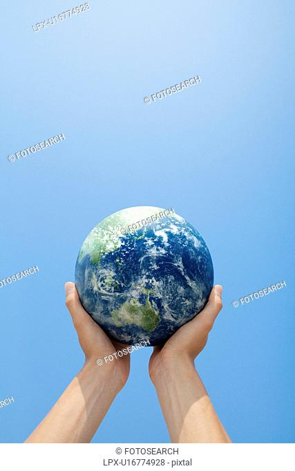 Person Holding Up Globe