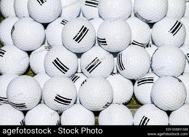 Close up view of a pile of white golf balls