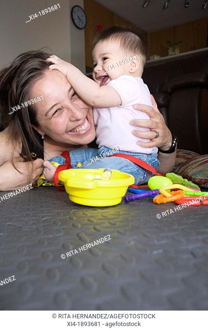 Mommy and baby playing in the floor