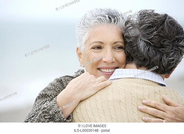 A senior couple embracing