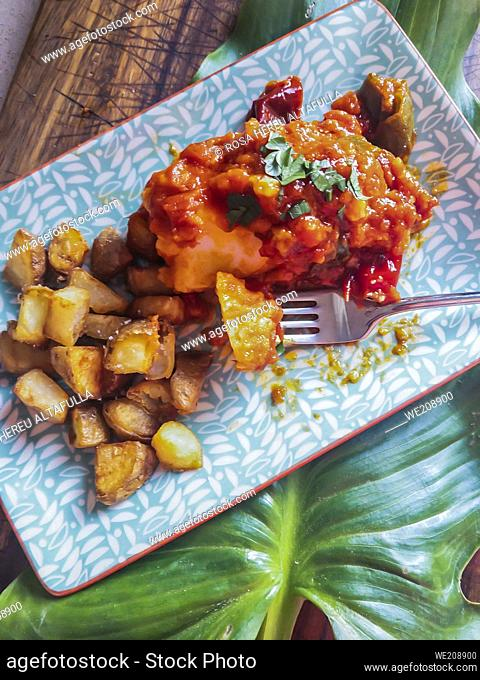 Cod with tomato sauce and potatoes