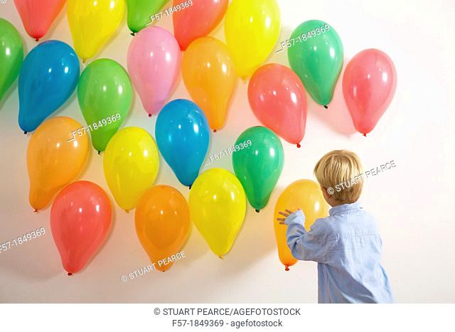 Children playing with balloons