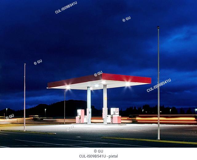 Empty floodlit gas station at night, Hof, Iceland