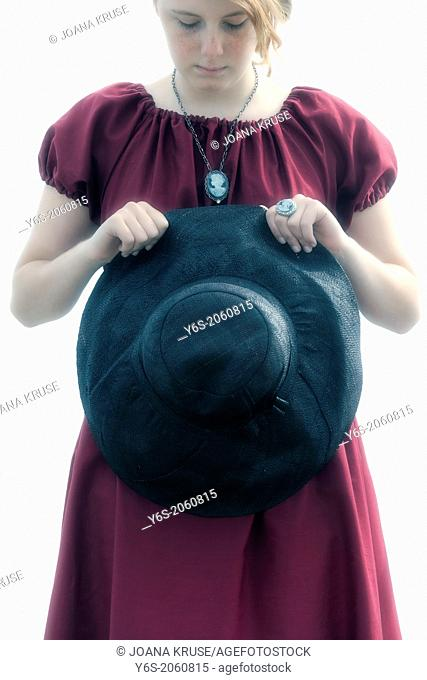 sad young girl with black sunhat