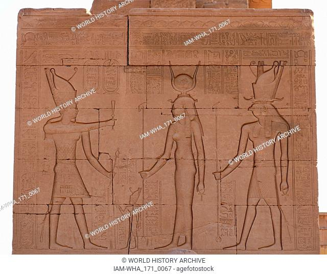Pharaoh standing before Hathor and Horus; wall relief at the Temple of Hathor at Dendera, Egypt. Temple of Hathor, Dendera, Egypt