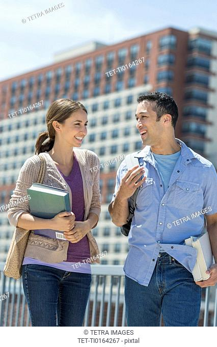 Male and female students walking in campus