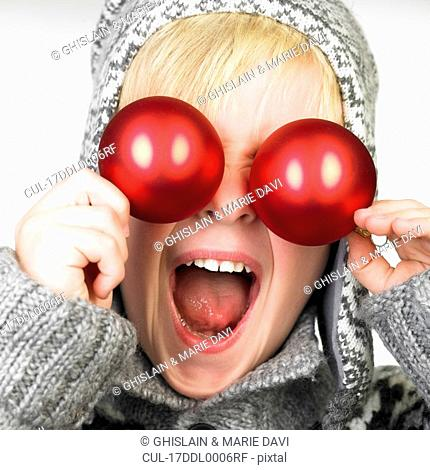 xmas decoration in front of boy\'s eyes