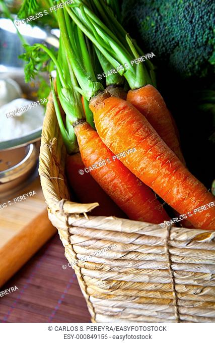 organic carrots in a rustic basket