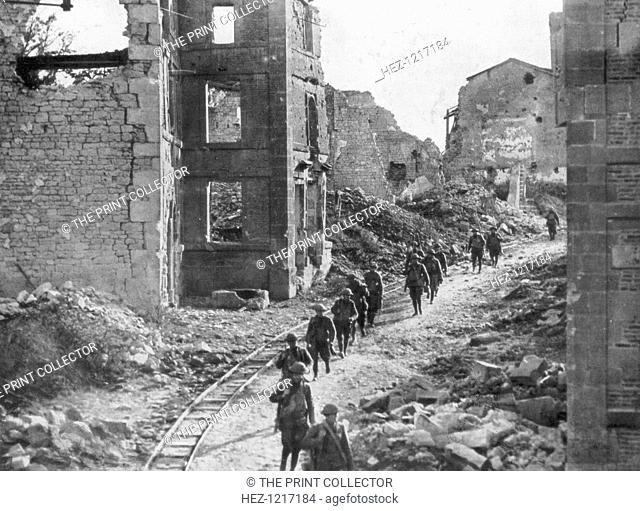 American soldiers passing through the ruins of Varennes, Meuse-Argonne Offensive, France, 1918. The Meuse-Argonne Offensive of September-November 1918 was the...