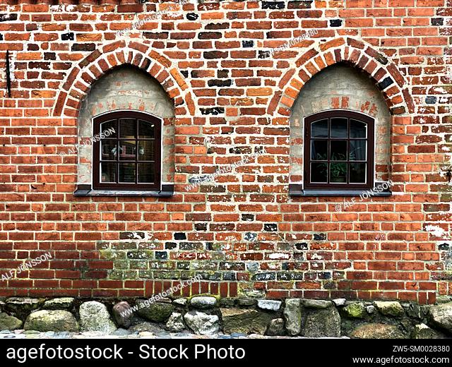 Two windows in a n old brick wall in a house from 16th centyry in Ystad, Scania, Sweden, Scandinavia