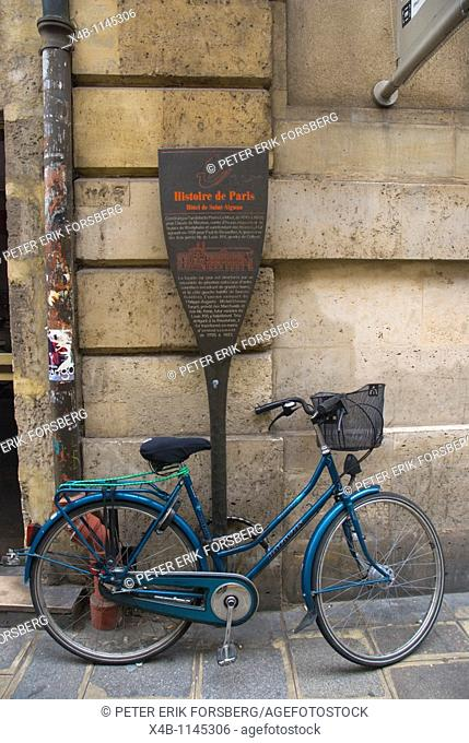 Parked and locked blue bicycle Le Marais district central Paris France Europe