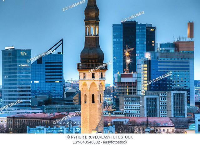 Tallinn, Estonia. Tower Of Town Hall On Background With Modern Urban Skyscrapers. City Centre Architecture