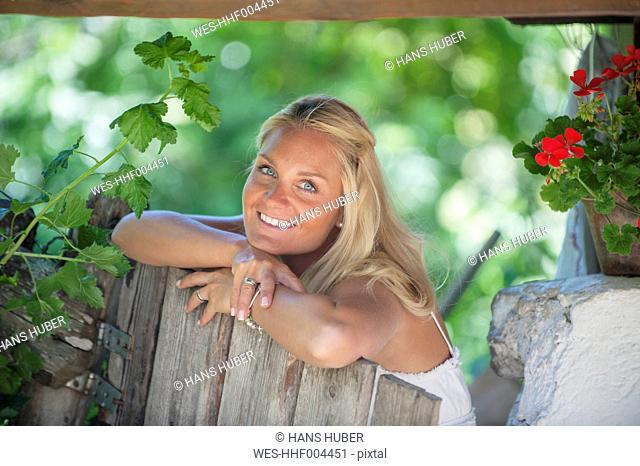 Austria, Altenmarkt-Zauchensee, Mid adult woman at alpine hut, smiling, portrait