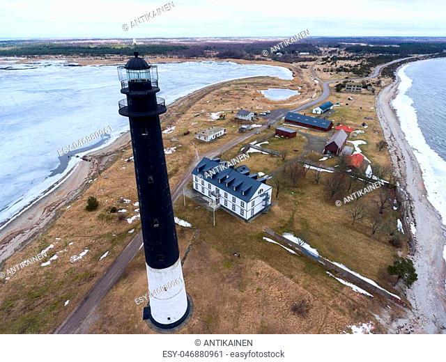 Sorve Lighthouse is black tower with horizontal wide white lower band. Peninsula in Torgu Parish, island Saaremaa, Estonia, Europe