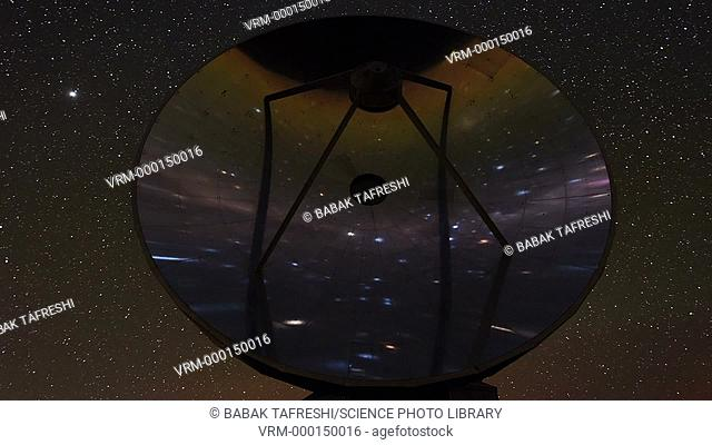 Night sky reflected in a radio telescope dish. Time-lapse footage of the stars and planets of the southern night sky reflected in the dish of the Swedish-ESO...