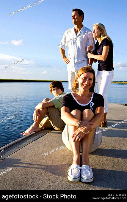 Mother and family, sunny day on dock
