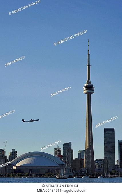 CN Tower and starting airplane in Toronto