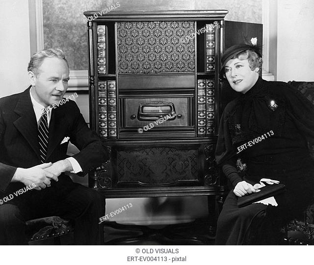 Couple listening to radio All persons depicted are not longer living and no estate exists Supplier warranties that there will be no model release issues