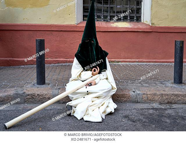 Seville: the distinctive cloaks and hoods capirotes of Spanish Holy Week processions, Spain