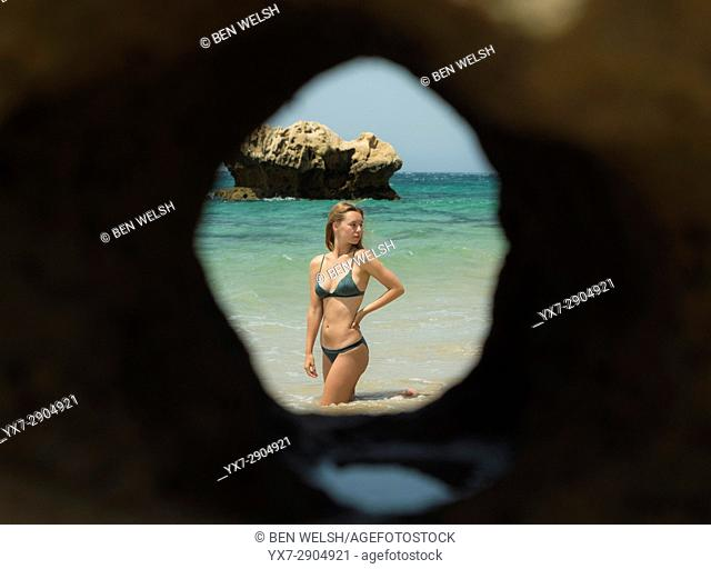 Young woman sunbathing. Tarifa, costa de la Luz, Cadiz, Andalusia, Spain