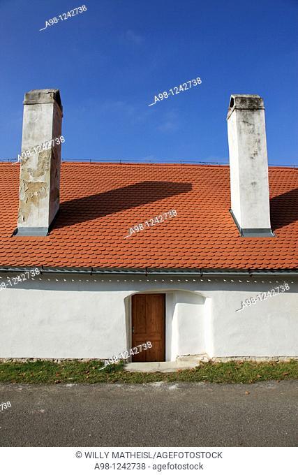 facade and entrance to an old fieldstone built building in the village of Zlata Koruna, Golden Crown, German Goldenkron, district of Cesky Krumlov, Sumava