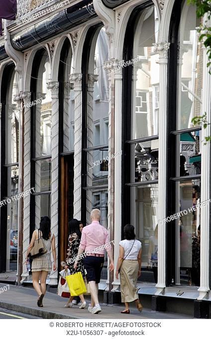 Foreign tourists passing Asprey jewellers in New Bond Street, London, England