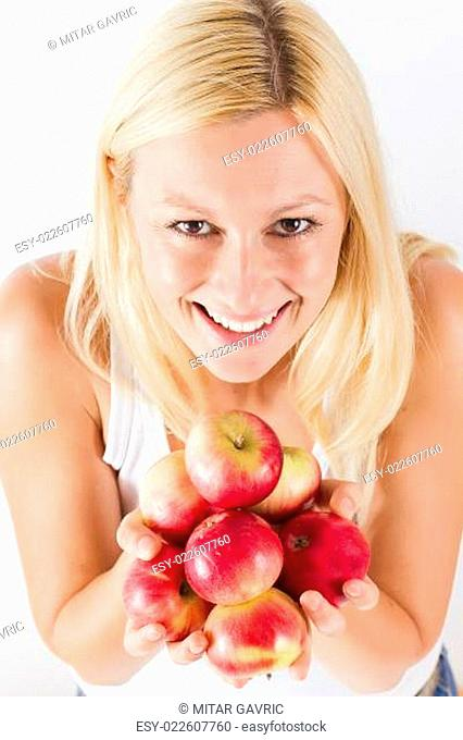 young woman holding red organic apple