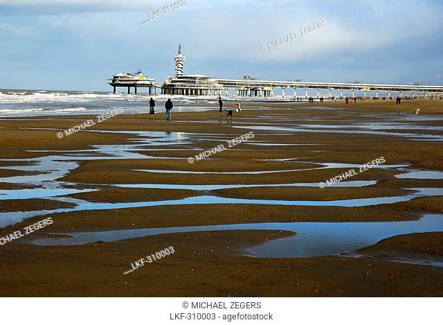 Pier at the beach of Scheveningen, ebb tide along the Dutch North Sea coast, The Hague, South-Holland, the Netherlands, Benelux