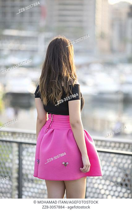 Rear view of a young woman standing outdoors