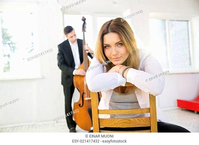 Woman backwards on chair dreaming of fame