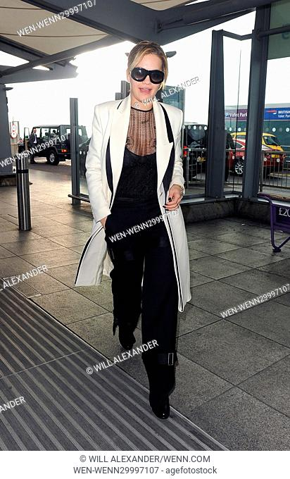Rita Ora and her sister Elena arrive at Heathrow Airport to fly out, having only spent 24hrs in the country. Rita showed off her cleavage with a low cut bustier...