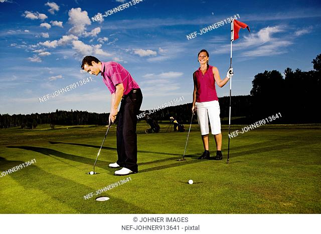Couple playing golf, Sweden
