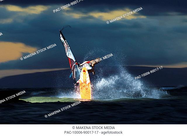 Hawaii, Maui, Kihei, Professional windsurfer Dean Christener sailing at sunset. FOR EDITORIAL USE ONLY