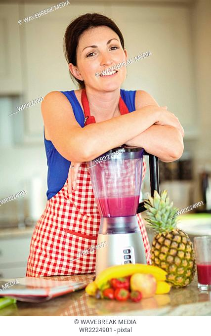 Woman leaning hand on mixer