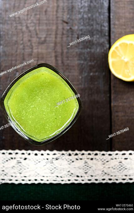 cucumber smoothie with lemon and sugar on wooden background