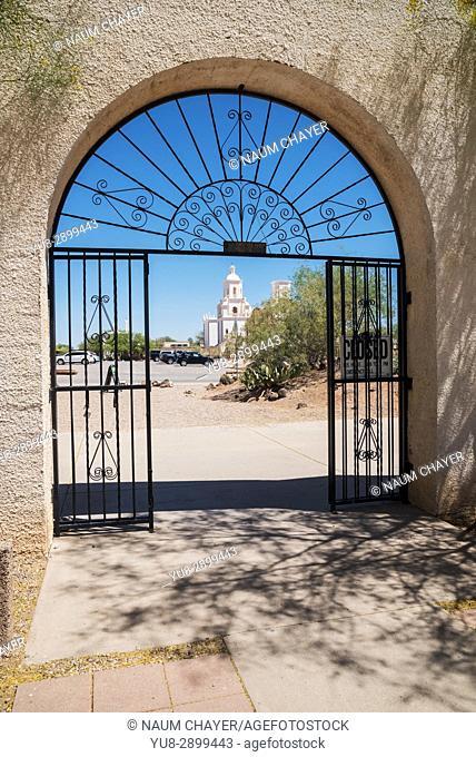 View on San Xavier Mission through the gate , Tucson , Arizona, USA