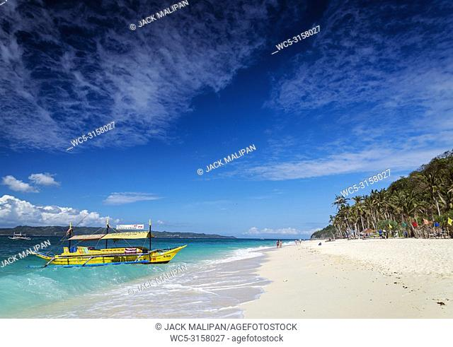 traditional filipino asian ferry taxi tour boats on puka beach in tropical boracay philippines