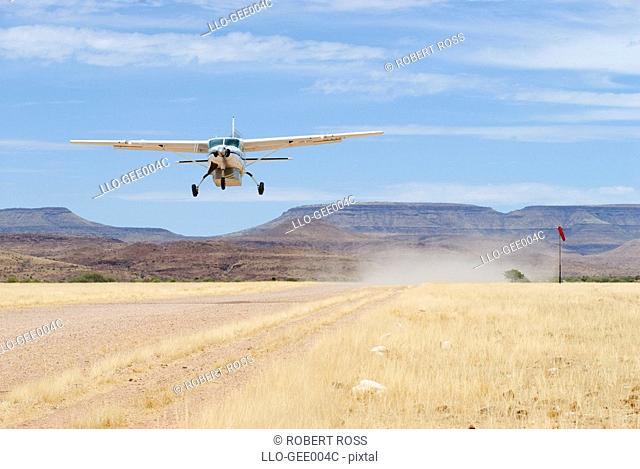 Small Private Plane Taking Off  Palmwag Airstrip, Damaraland, Namibia, Africa