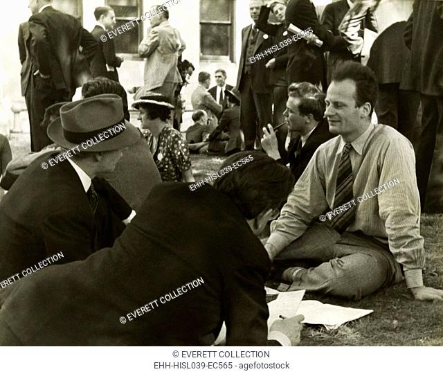 Hans Bethe, being interviewed by journalists in the late 1930s. Bethe, a German-American physicist, would win the 1967 Nobel Prize in physics for his work on...