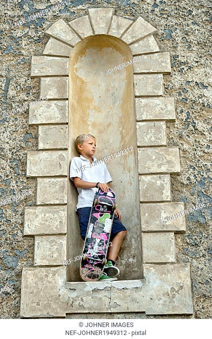Boy with skateboard, Sodermanland, Sweden