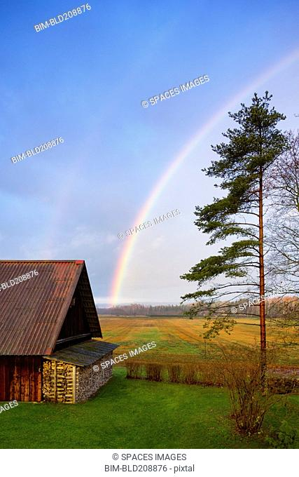 Rural scene, a rainbow in the sky, after rain