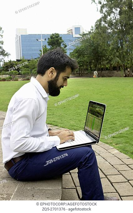 Corporate person working on a laptop, Magarpatta city, Pune, Maharashtra, India