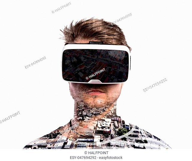 Double exposure. Hipster man wearing virtual reality goggles. City with various buildings. Isolated