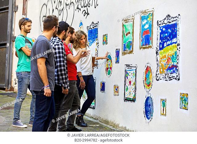 Group of tourists and guide making a tour of the city, Graffiti, Gaztelubide street, Donostia, San Sebastian, Gipuzkoa, Basque Country, Spain, Europe