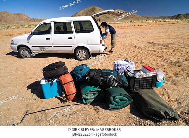 Baggage in front of a car which is stuck in the sand, Richtersveld National Park, Northern Cape, South Africa, Africa