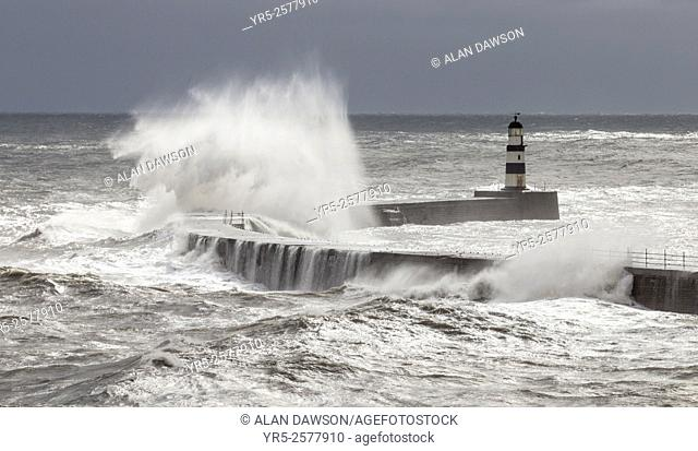 Storm waves crashing over harbour wall at Seaham, County Durham, north east coast of England, United Kingdom