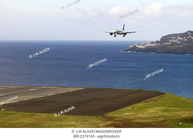 Landing approach of a passenger plane of First Choice Airways at the airport of Madeira, LPMA, Funchal Airport or Airport Santa Catarina, Madeira, Portugal