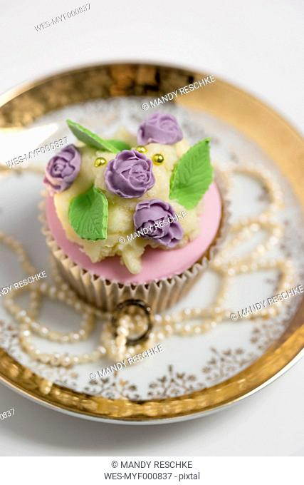 Cupcake with rose blossom fondant and buttercream
